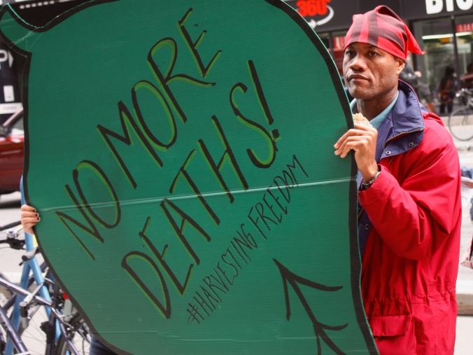 Migrant worker Leon Ferguson at a rally in Ottawa as part of J4MW's Harvesting Freedom caravan.